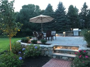 natural Stone retaining wall stone patio stone stairs with granite treads and paver walkway