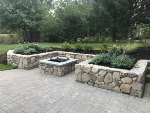 paver patio with stone fireplace bbq and stone retaining wall