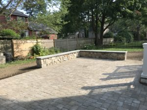 paver patio with landscape stone wall